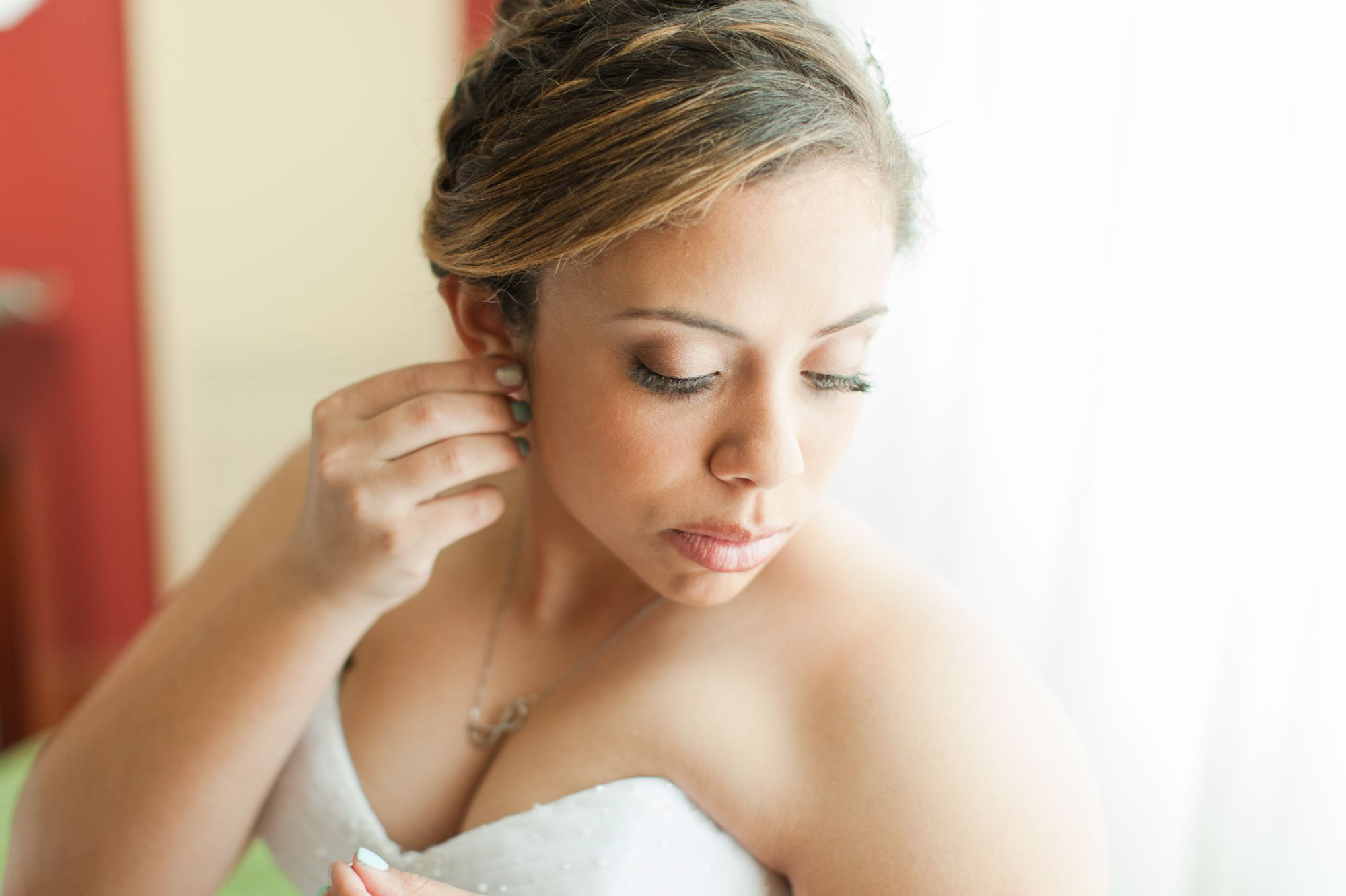 bride getting ready for wedding pictures