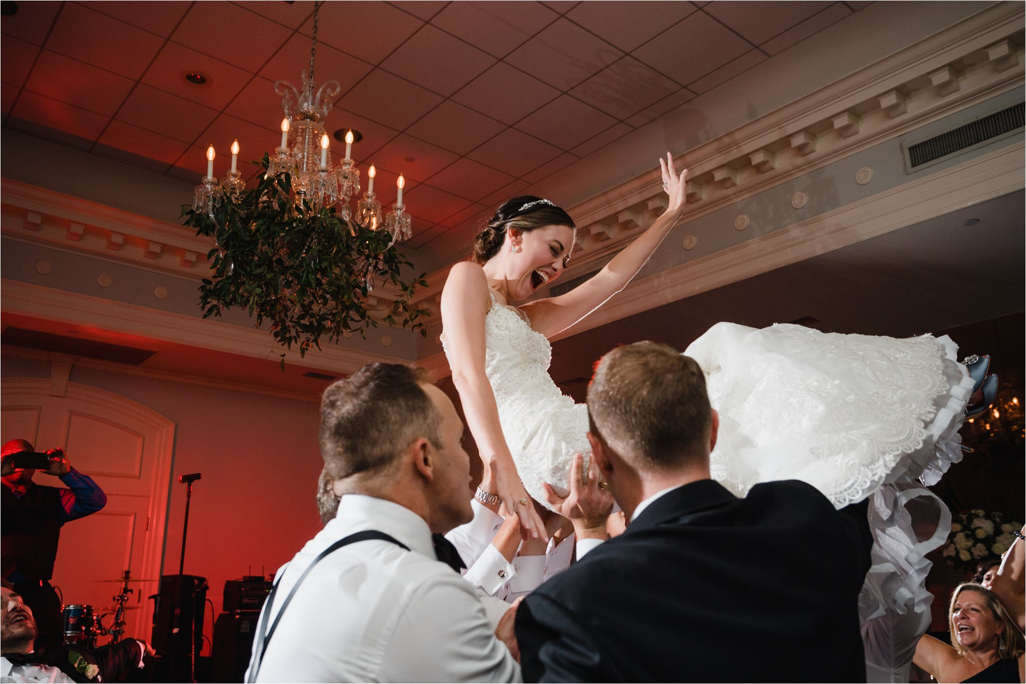 Bride lifted up dancing at wedding