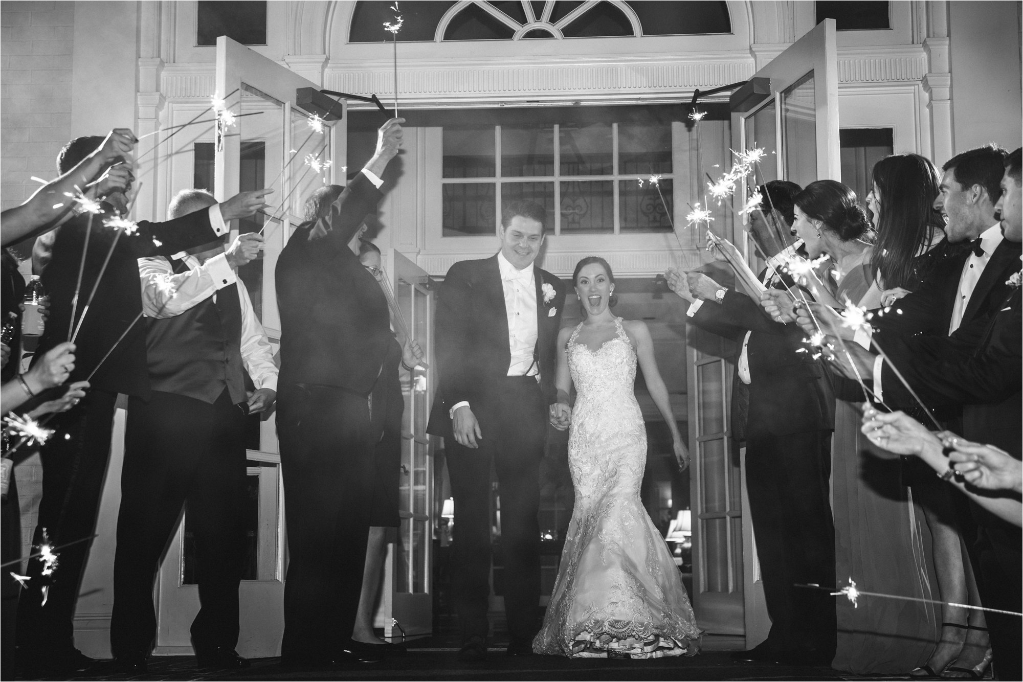 black and white of wedding sparkler exit