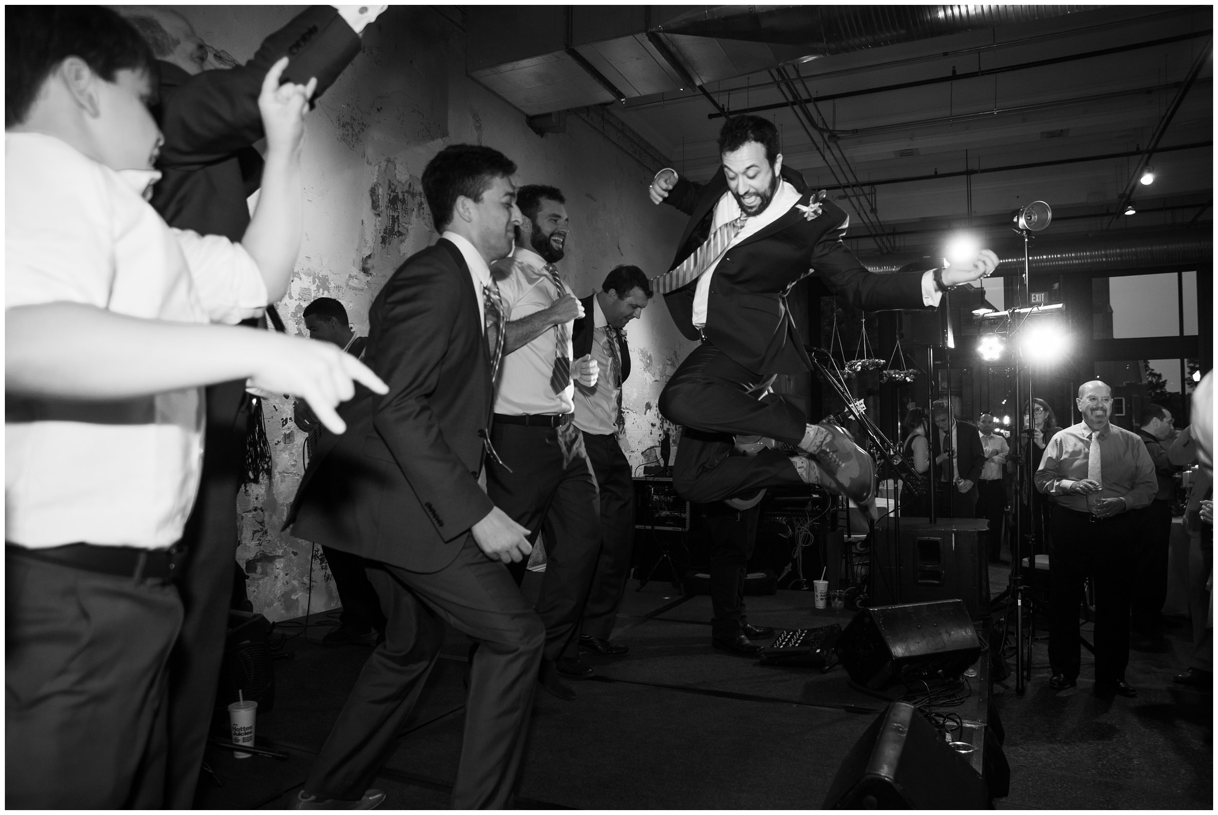 groom and groomsmen dancing during reception columbia wedding venue