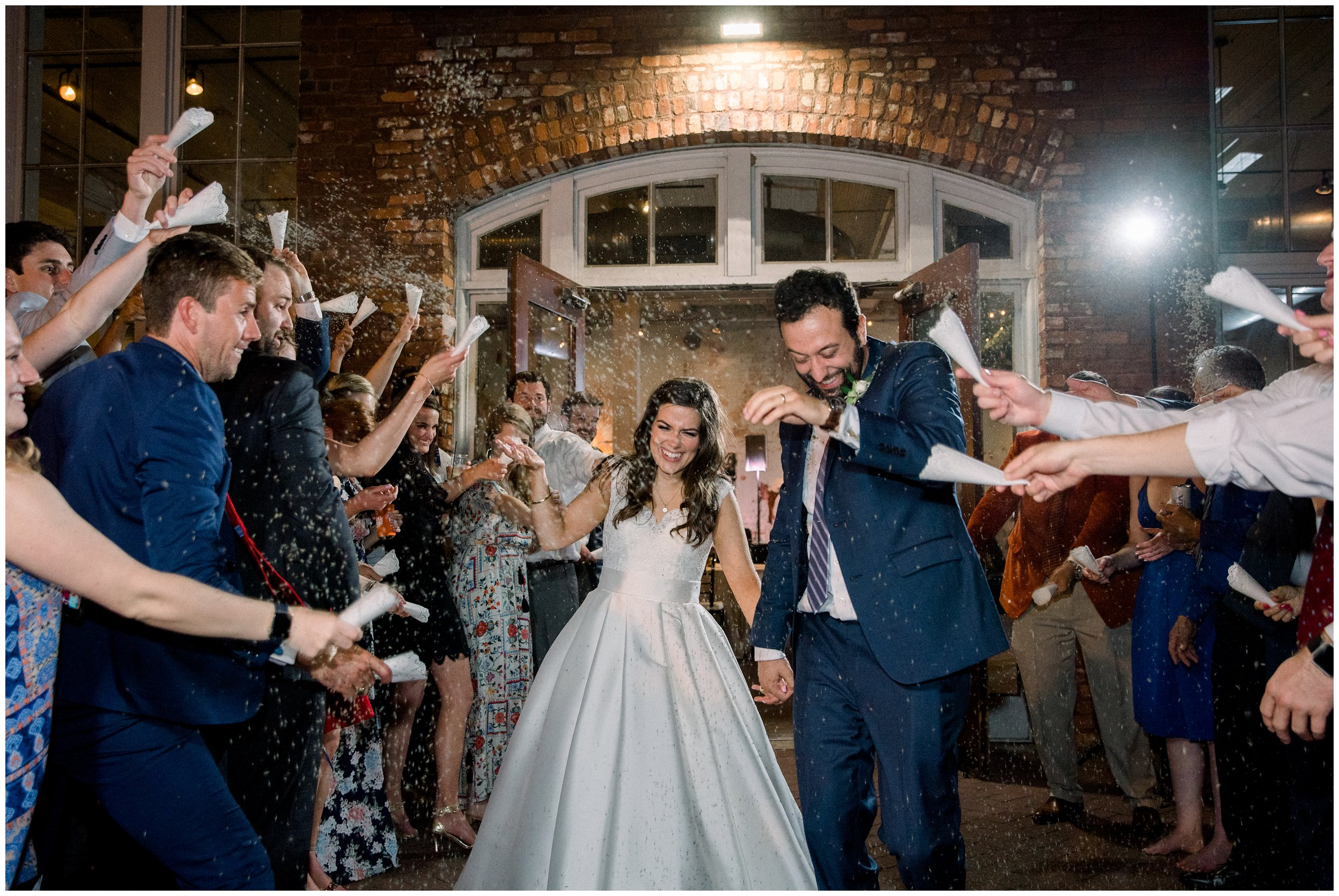 guests throwing lavender as bride and groom exit columbia wedding venue