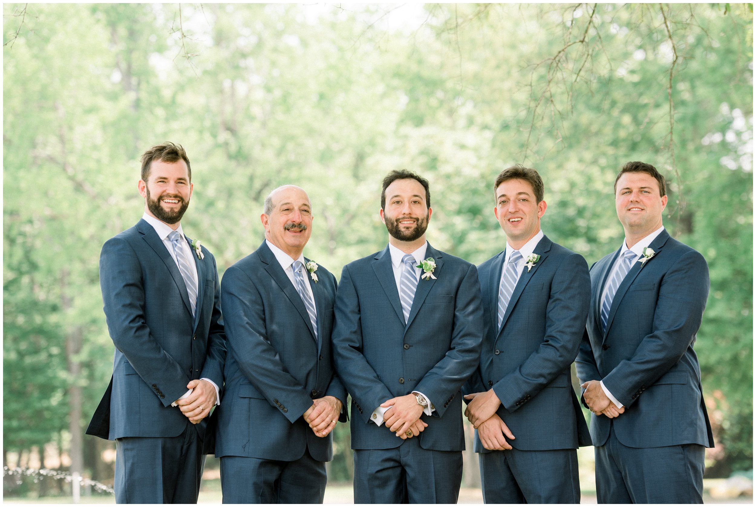 groomsmen portrait with groom