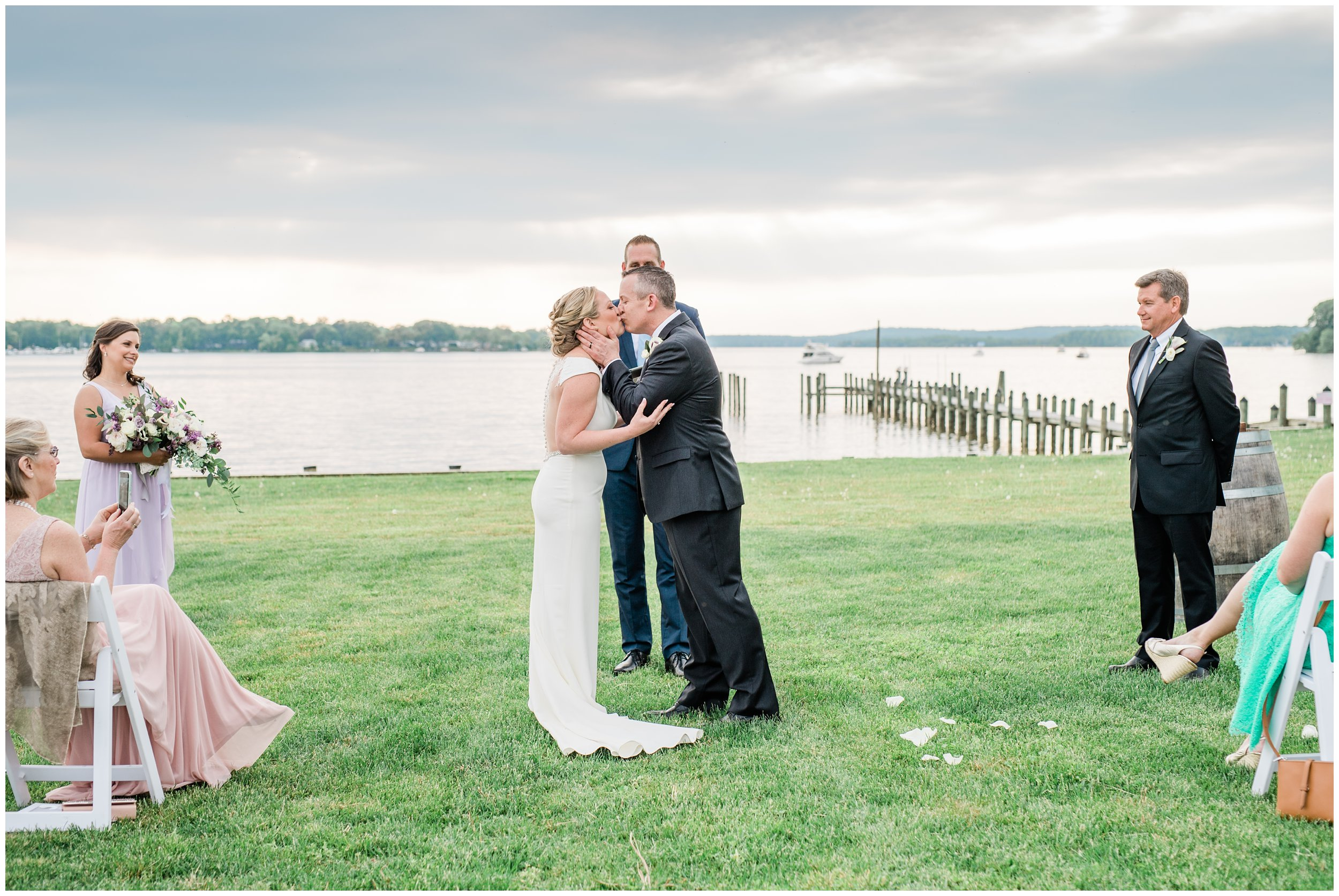 first kiss as husband and wife maryland waterfront