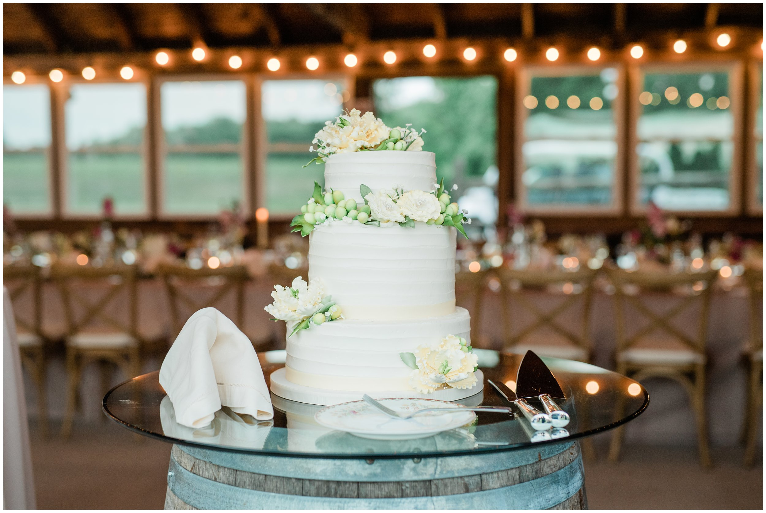 beautiful white wedding cake decorated with flowers