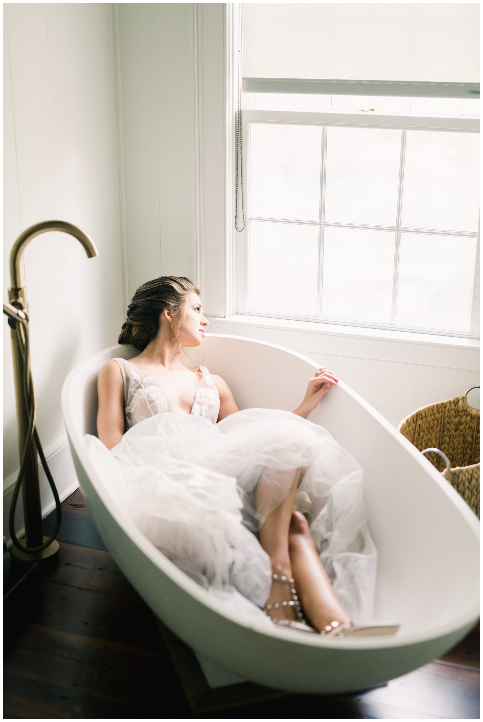unique bridal portrait in vintage bathtub