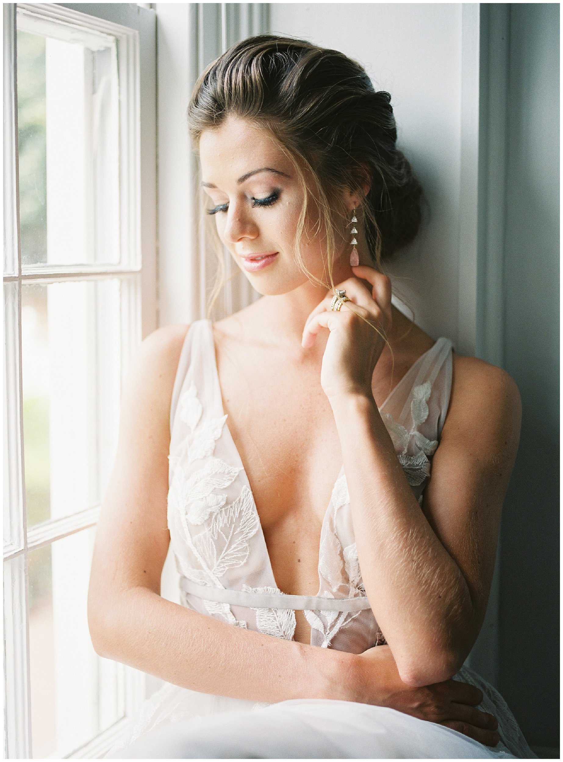 stunning bridal portrait next to window at tipsy goat estate