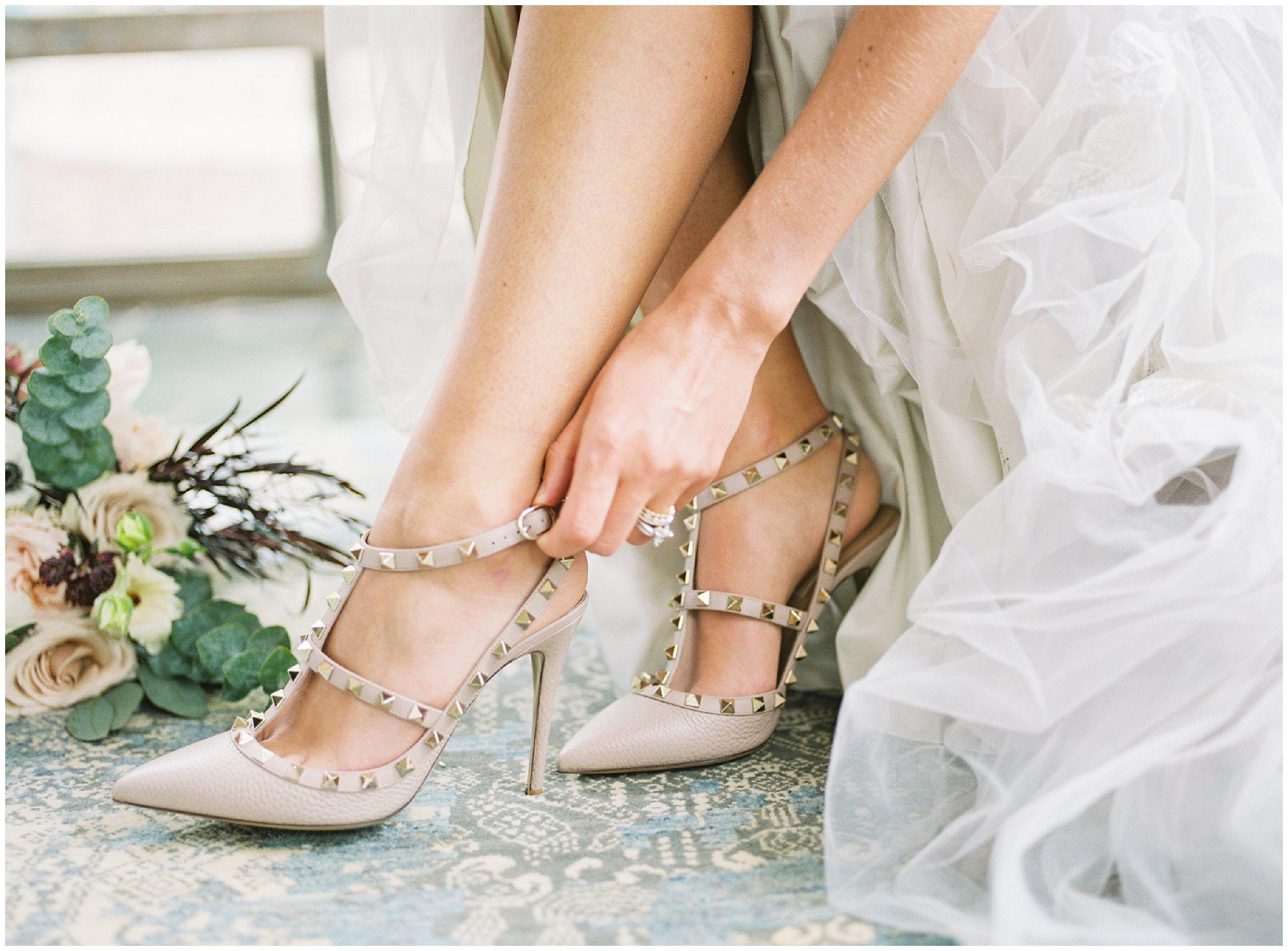 charlotte wedding details, bride putting on shoes