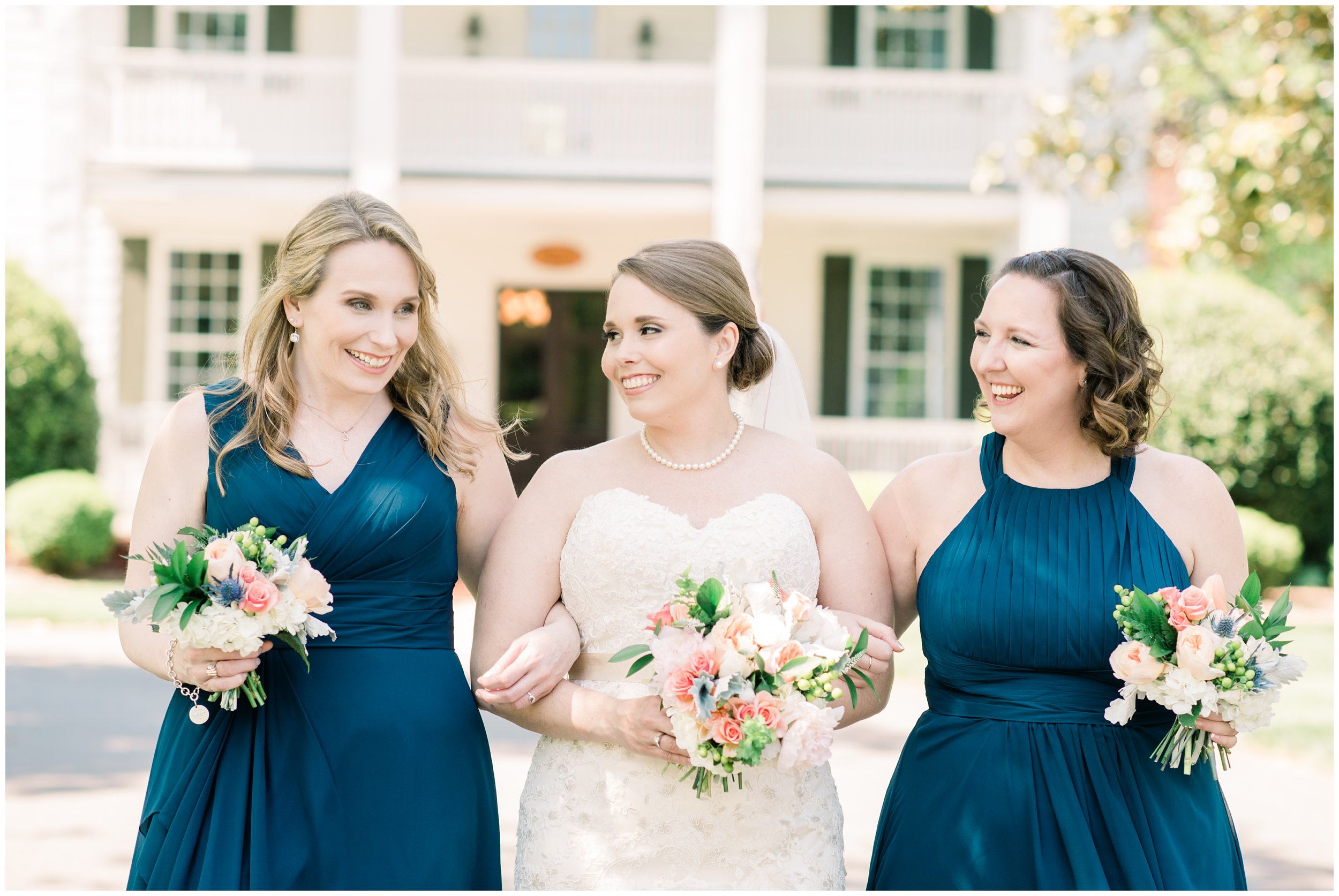 bride with bridesmaids outside langtree plantation