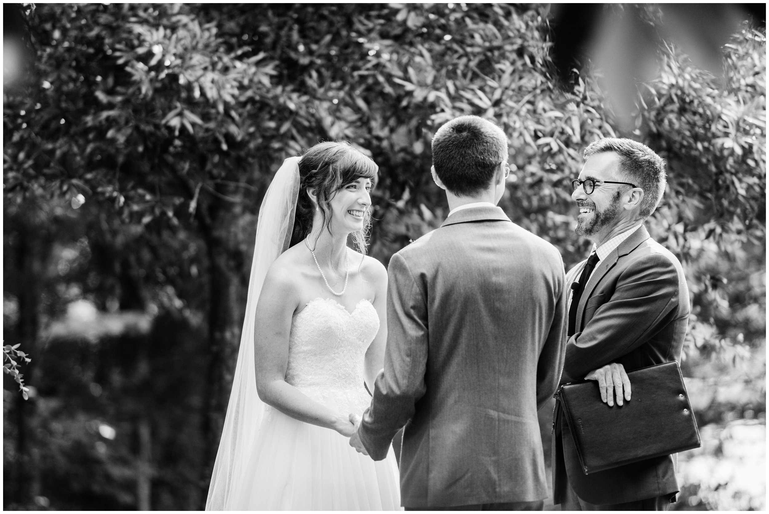 bride and groom laughing during charlotte wedding ceremony