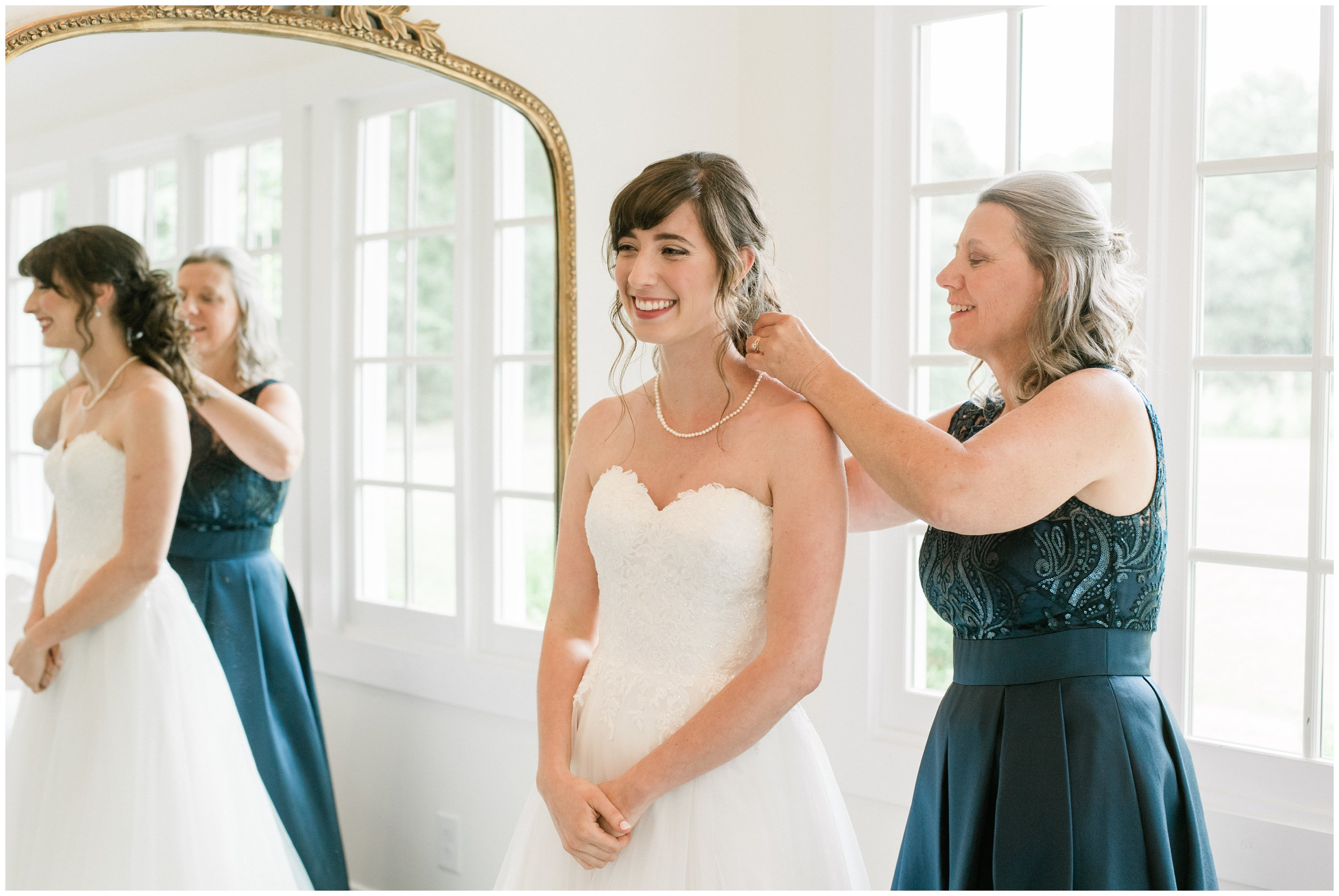 mother of the bride helping bride get ready charlotte wedding
