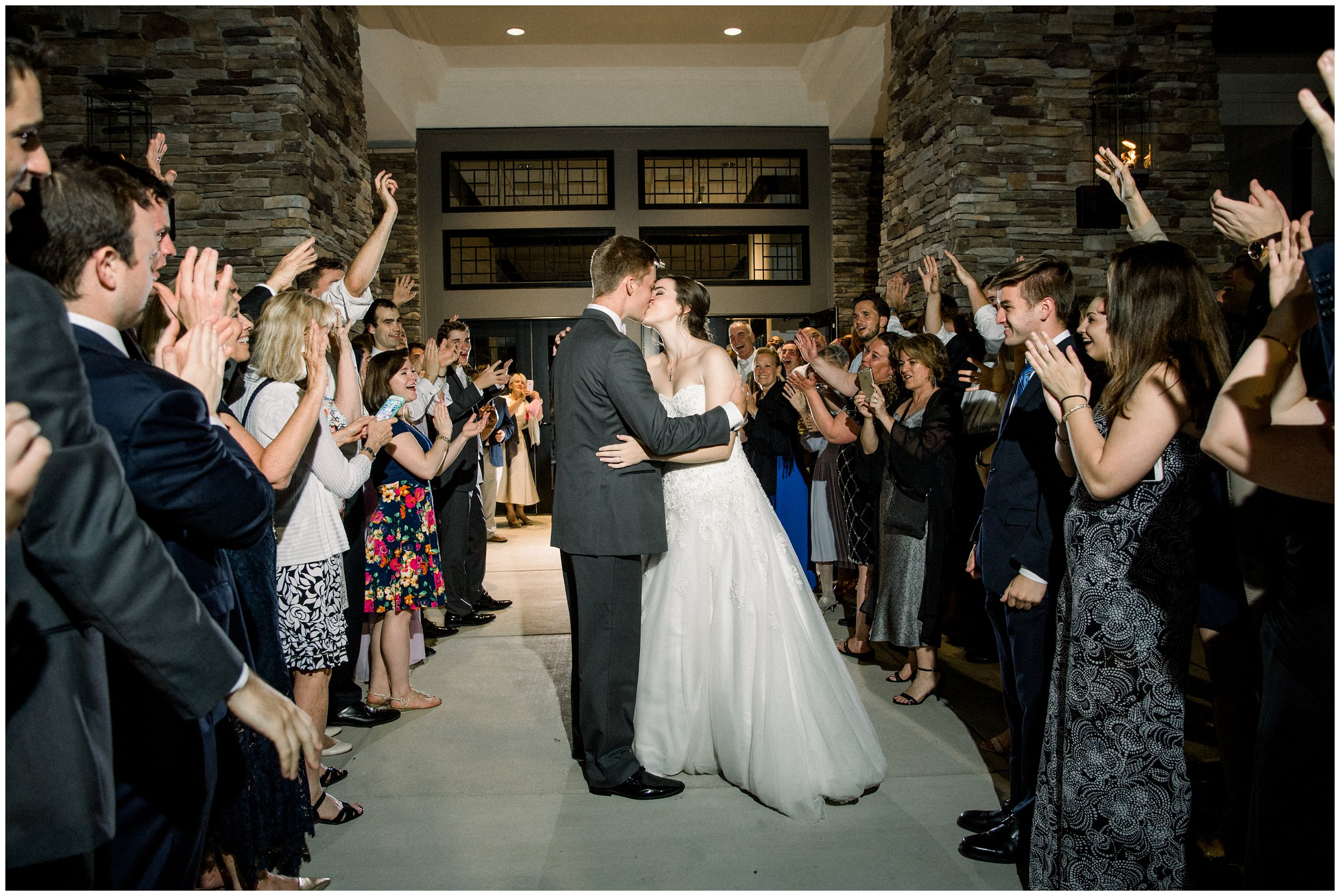 bride and groom kiss reception exit