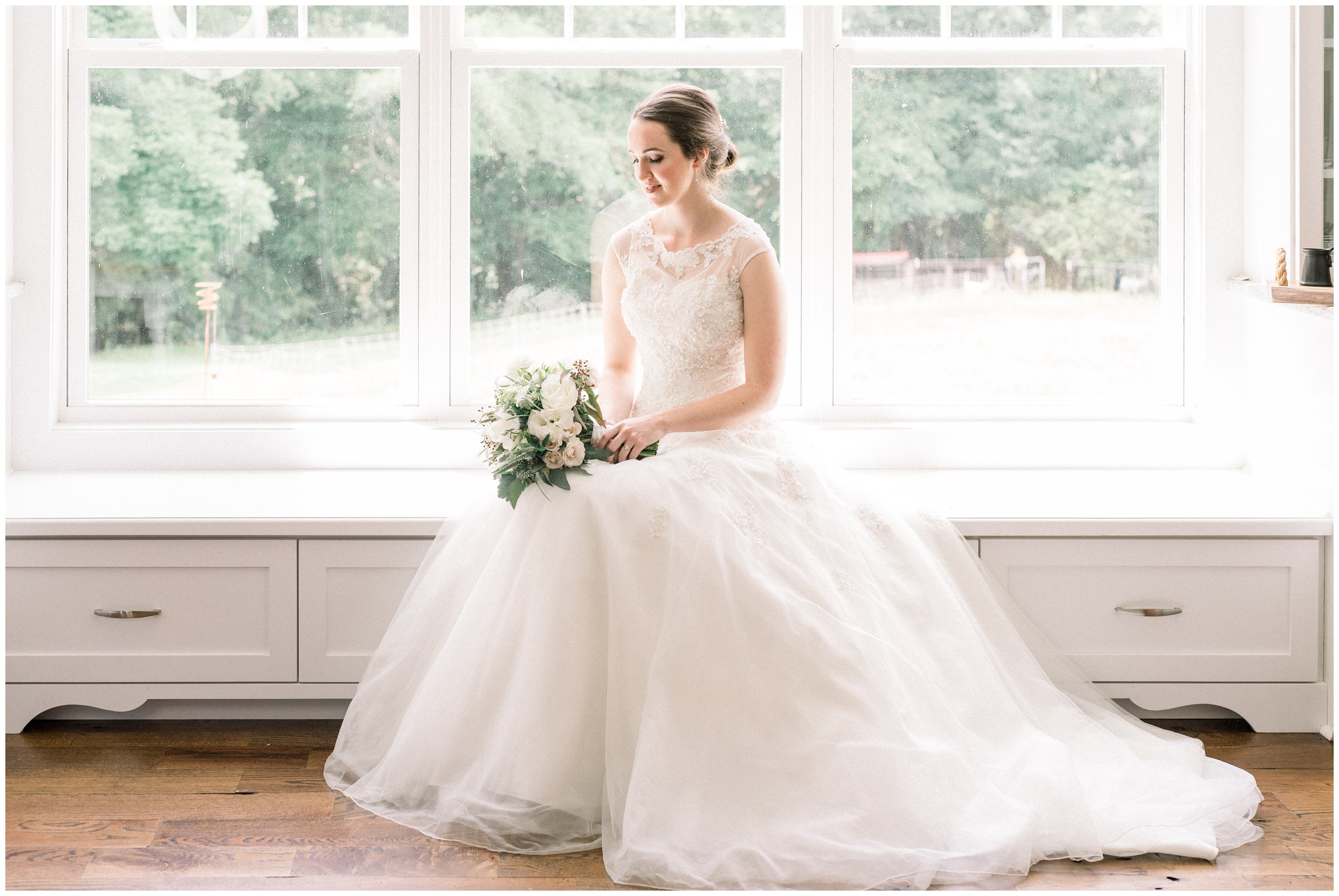 lovely bridal portrait next to window rock hill wedding