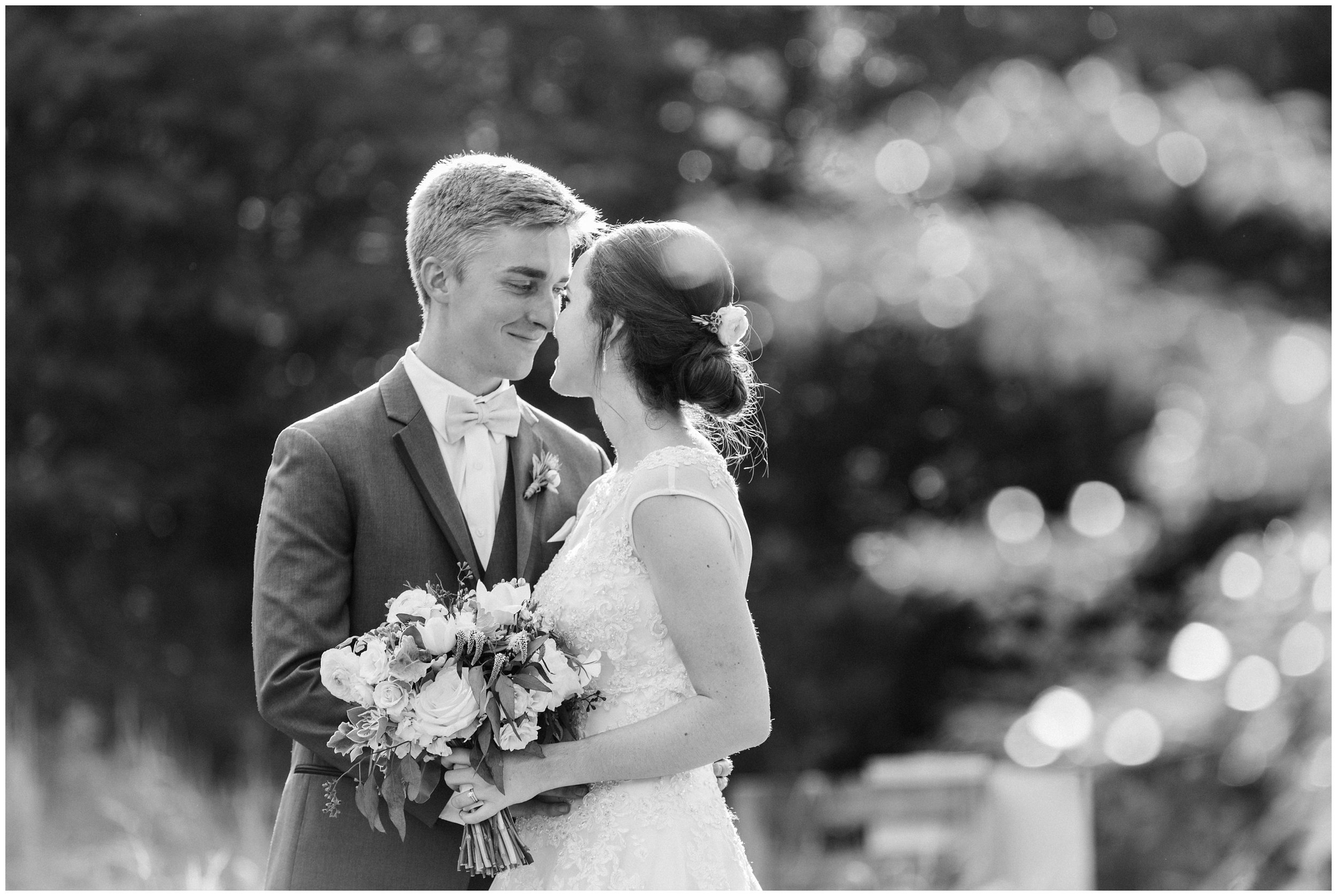 bride and groom sharing a sweet moment after ceremony