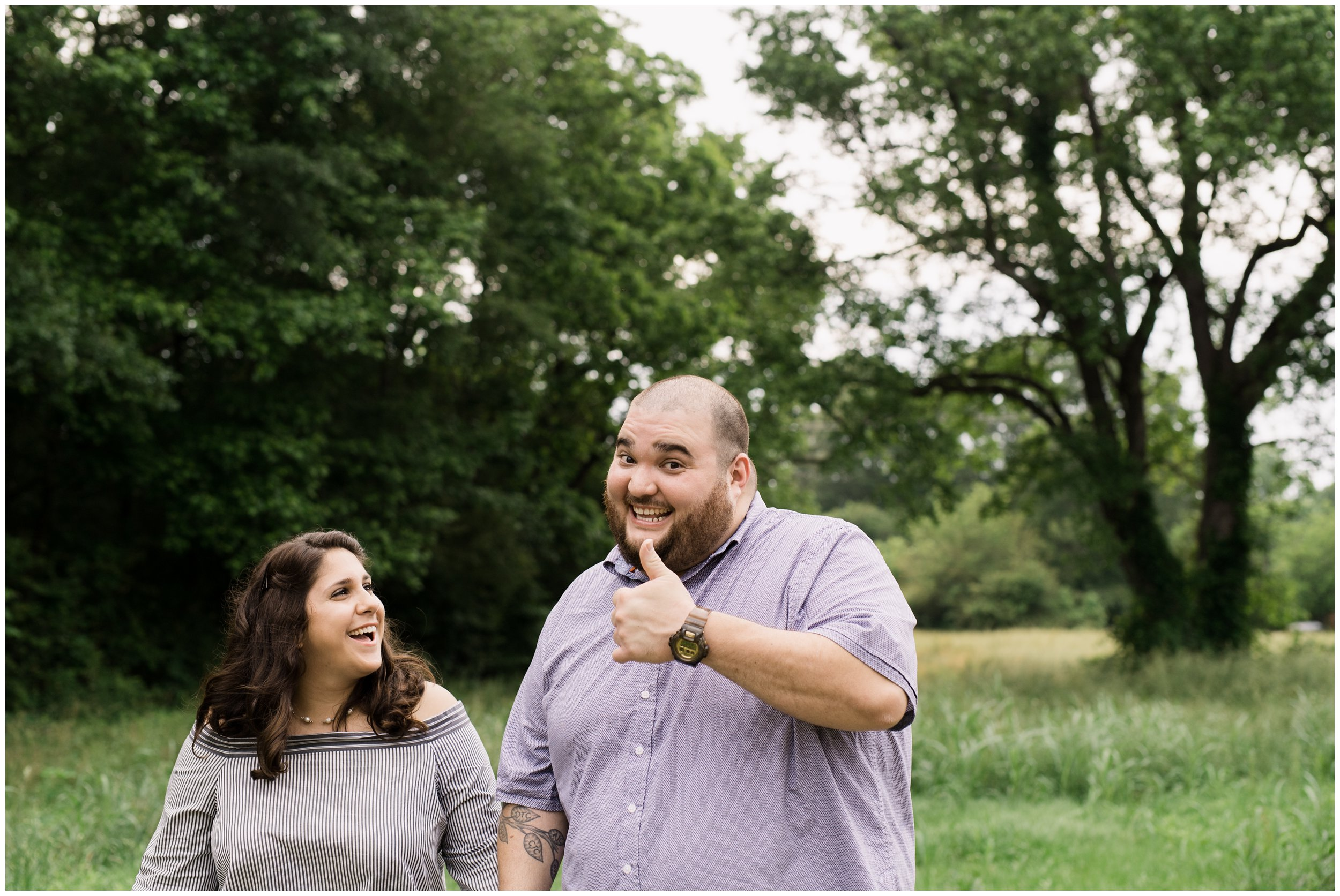 thumbs up from fiance treehouse vineyard engagement photos