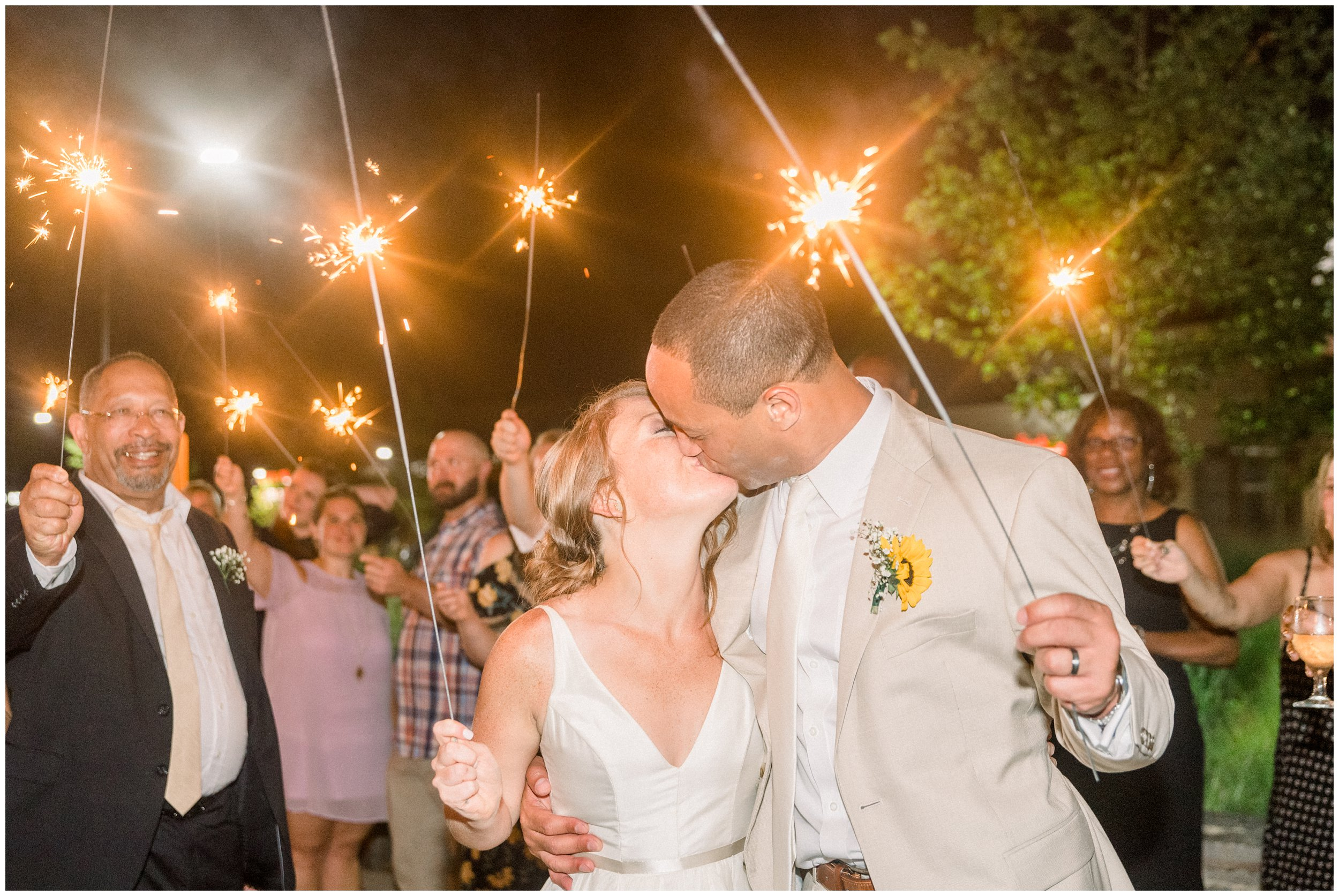 charlotte wedding sparkler exit bride and groom kissing