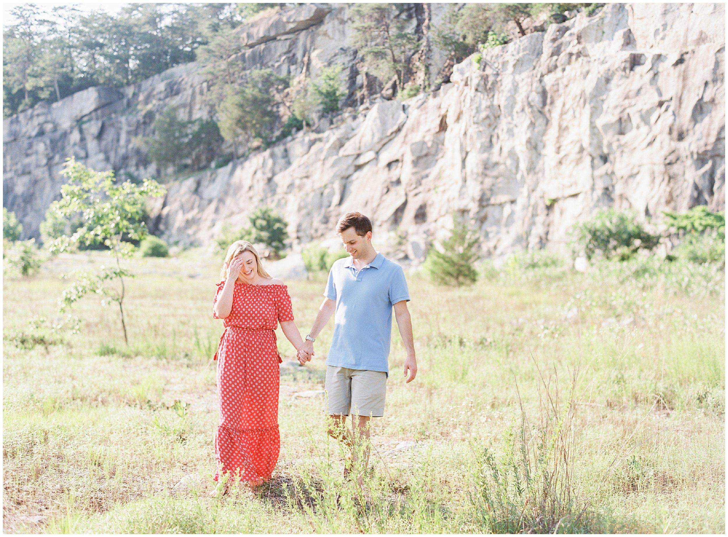 Couple walking in open field, NC engagement photos