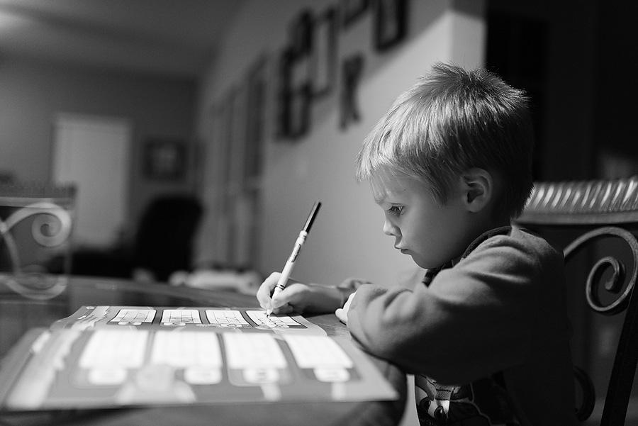 boy doing preschool homework