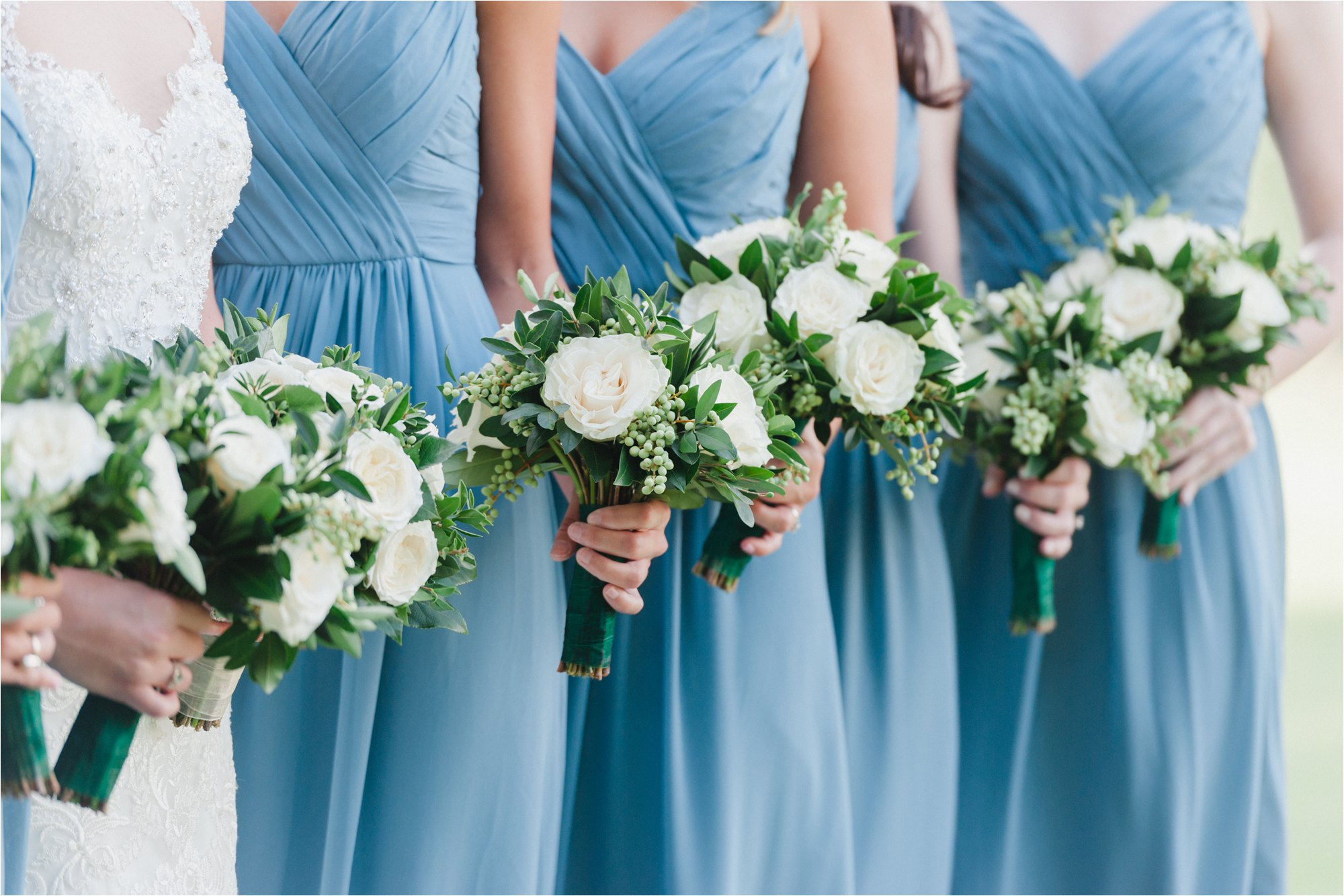 white and green bouquets with blue bridesmaid dresses