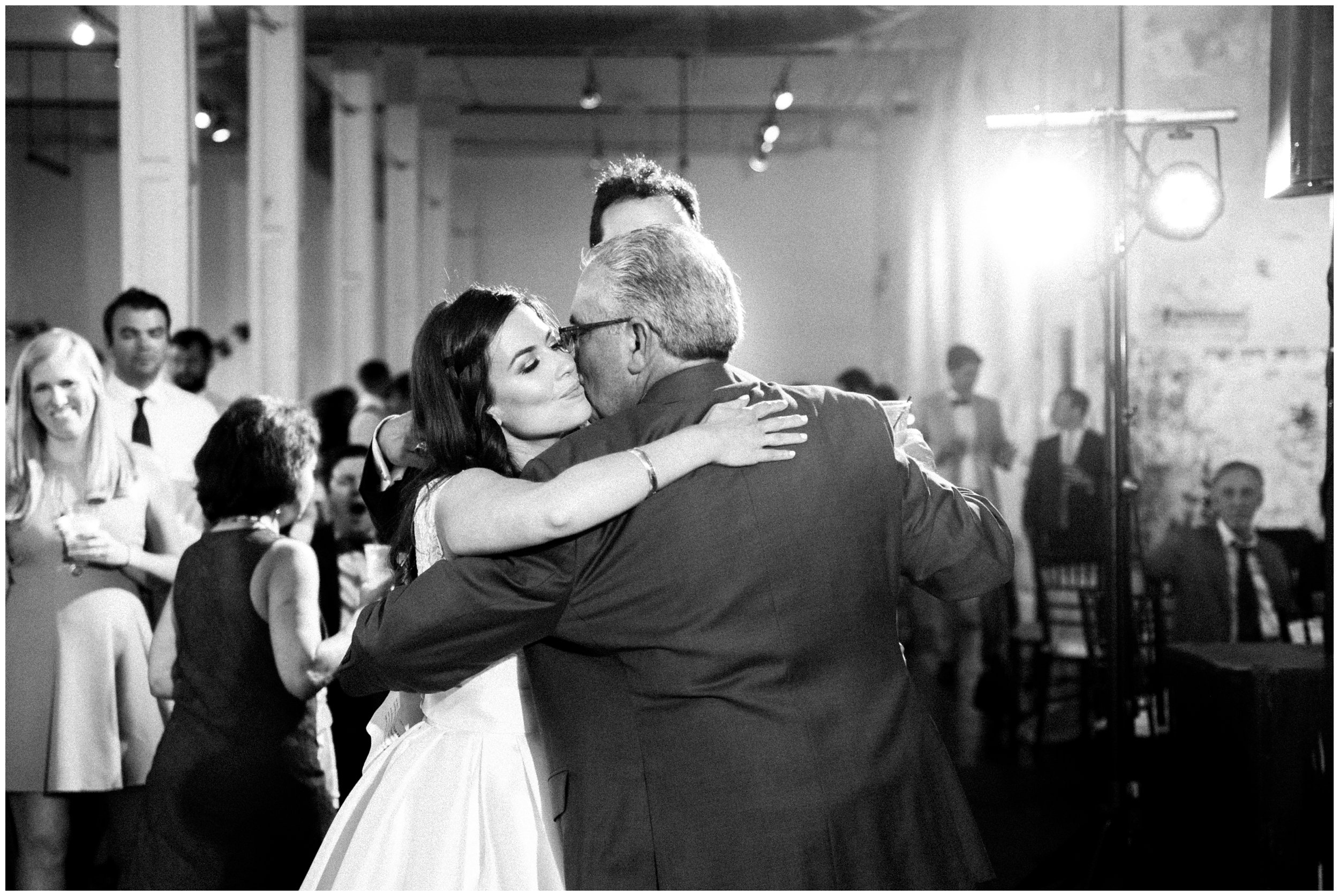 sweet moment of bride hugging dad after his toast