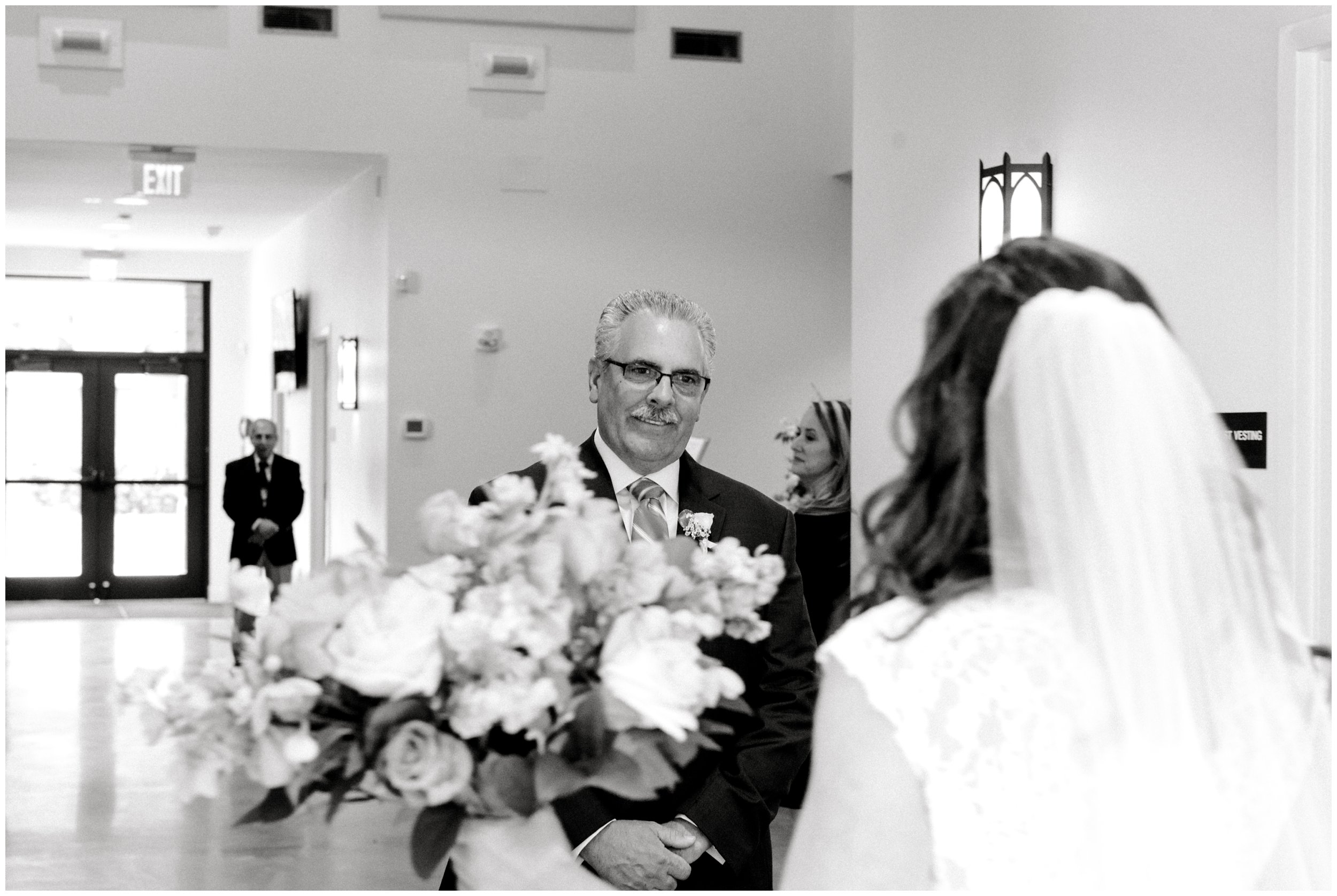 father seeing daughter for the first time before she walks down the aisle