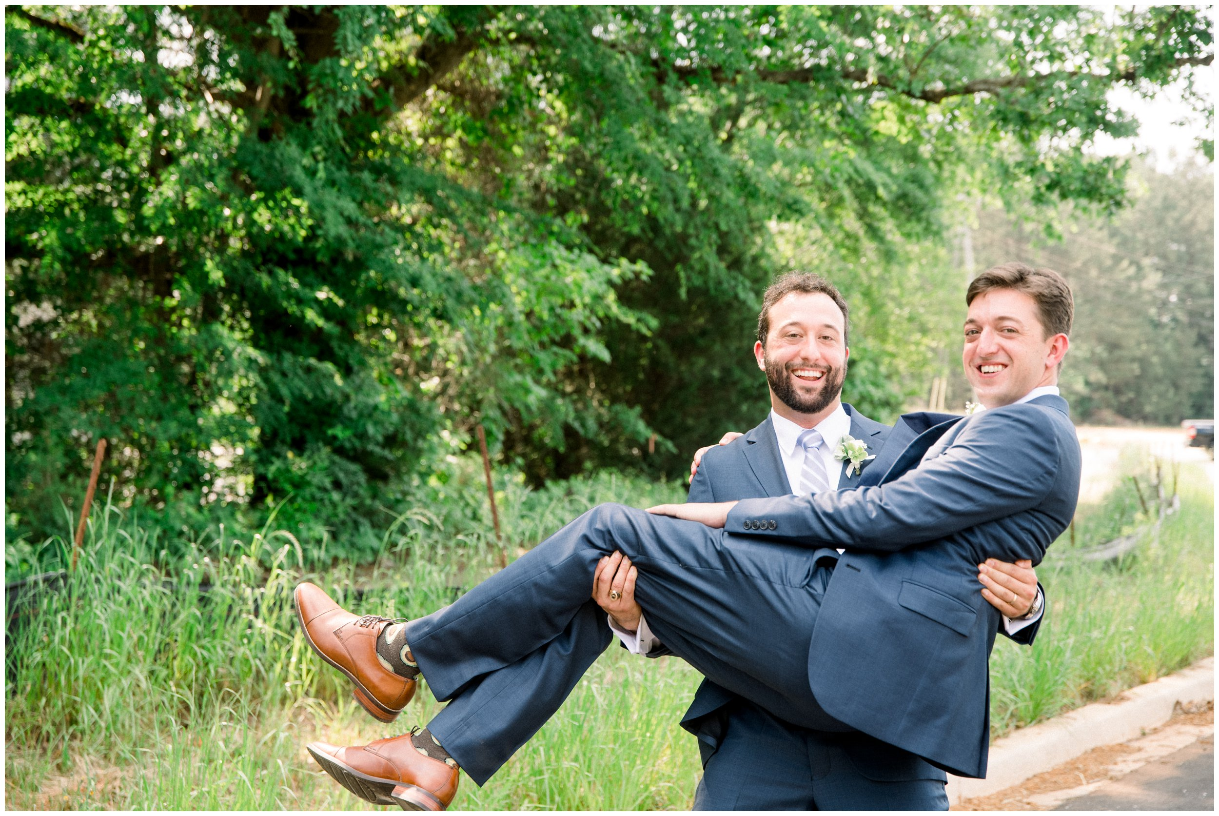 groom and groomsman laughing before wedding