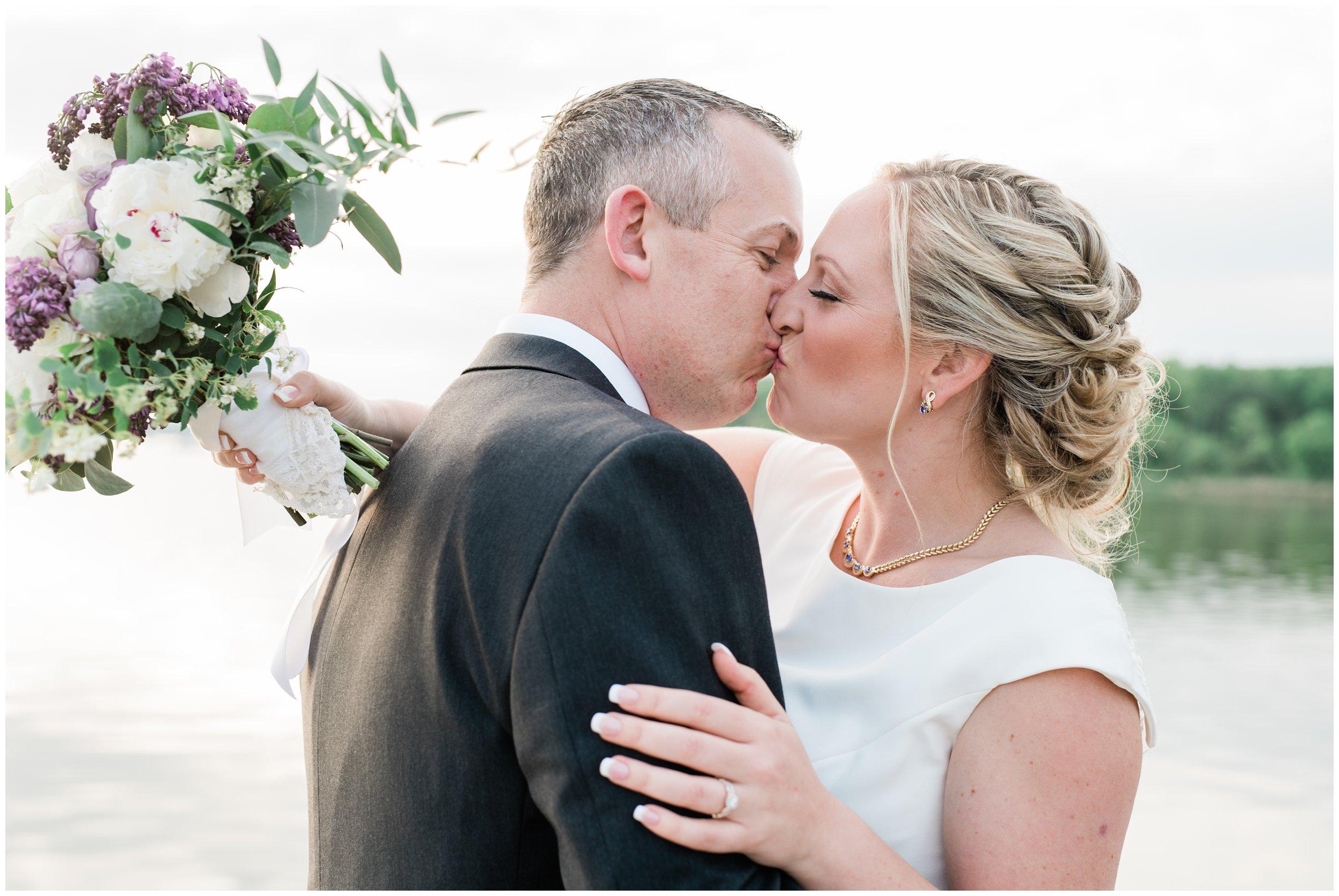 maryland sunset kiss on dock newlyweds