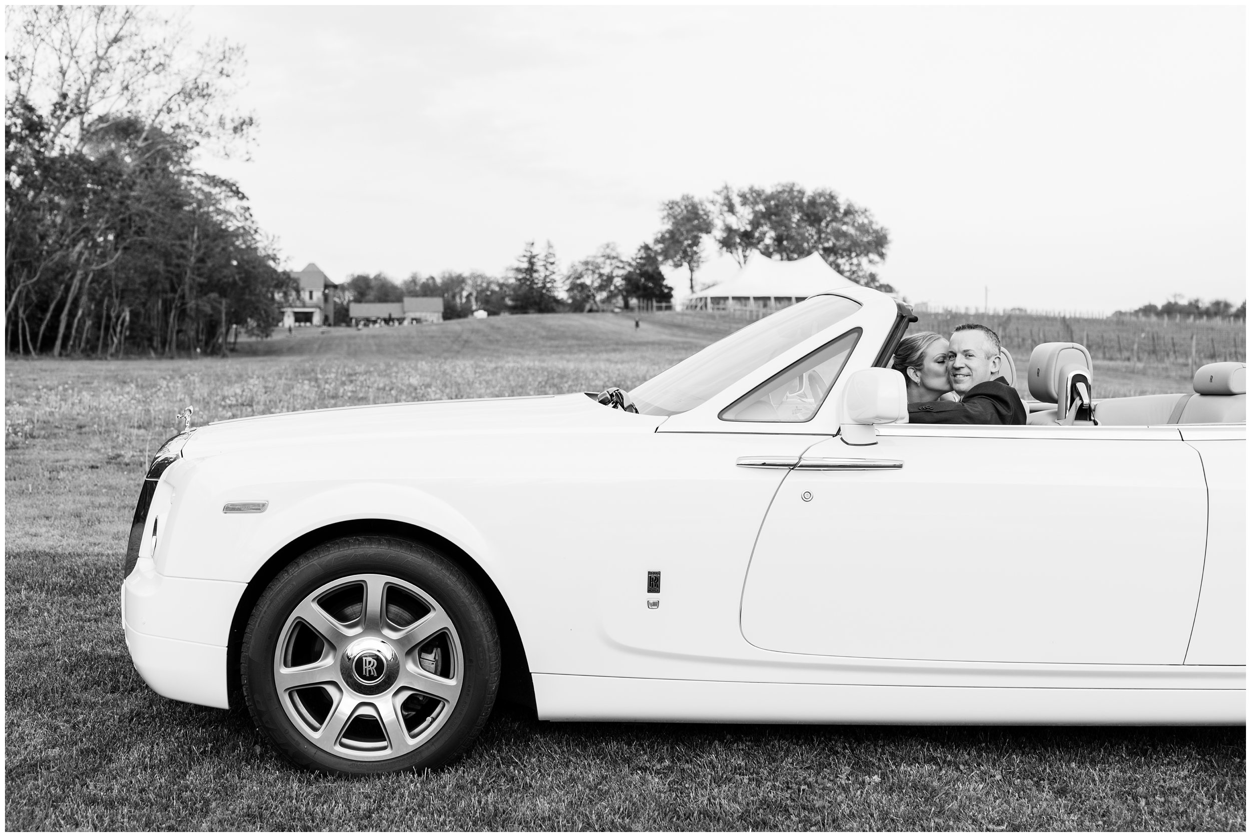 husband and wife driving rolls royce after wedding