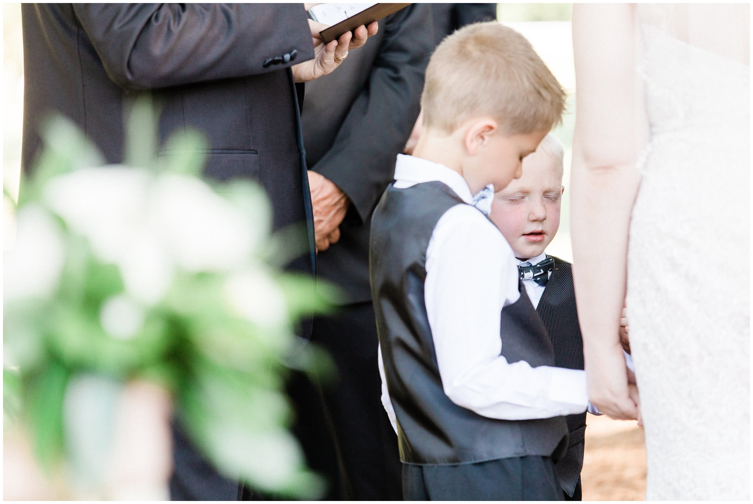 little boy praying during charlotte wedding ceremony