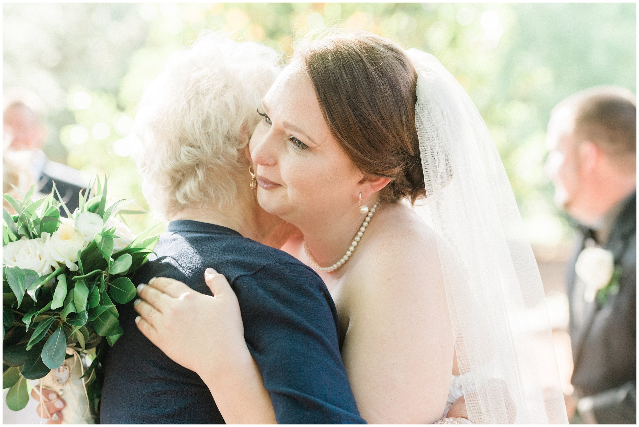 emotional bride hugging grandmother