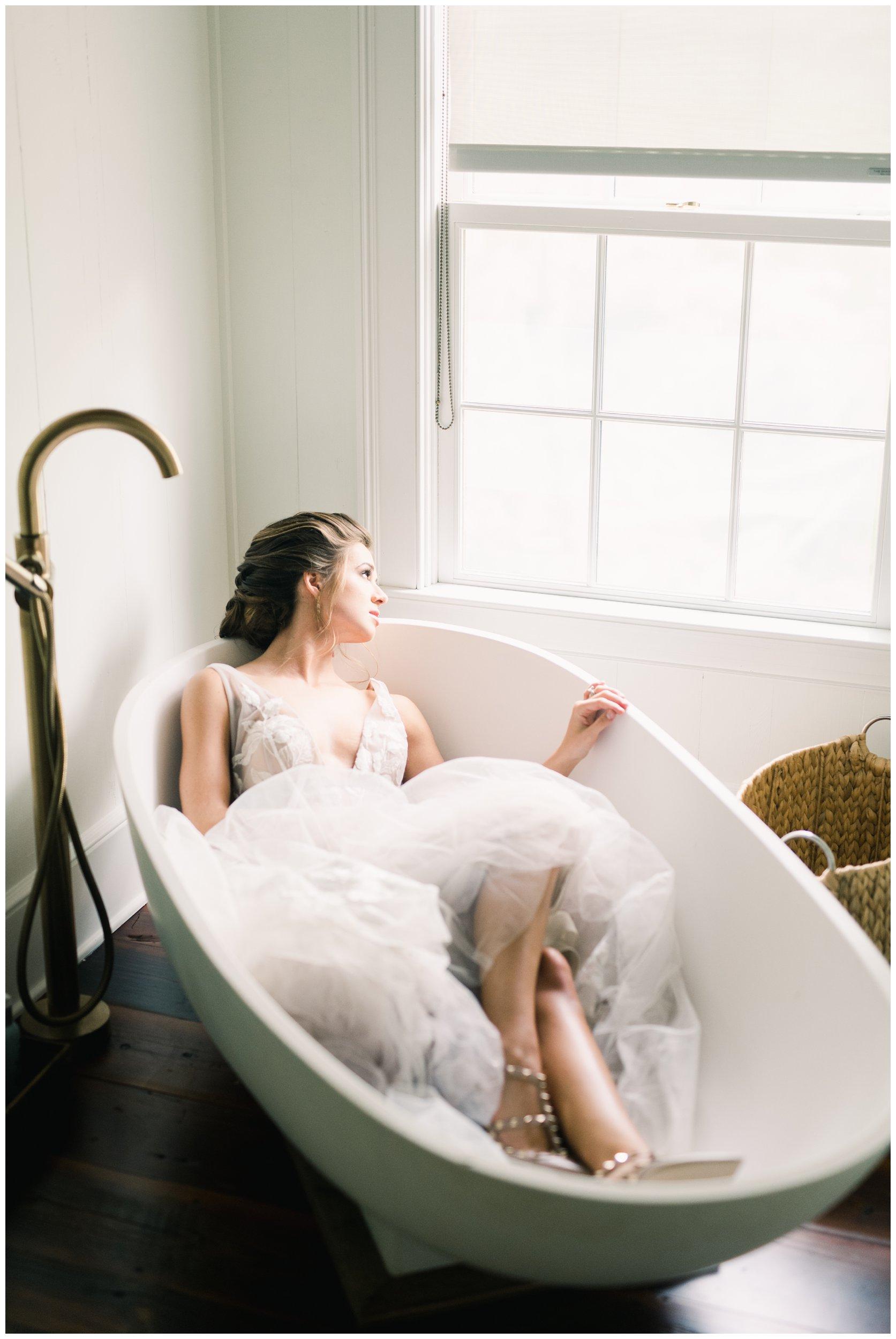 unique bridal portrait in vintage bathtub