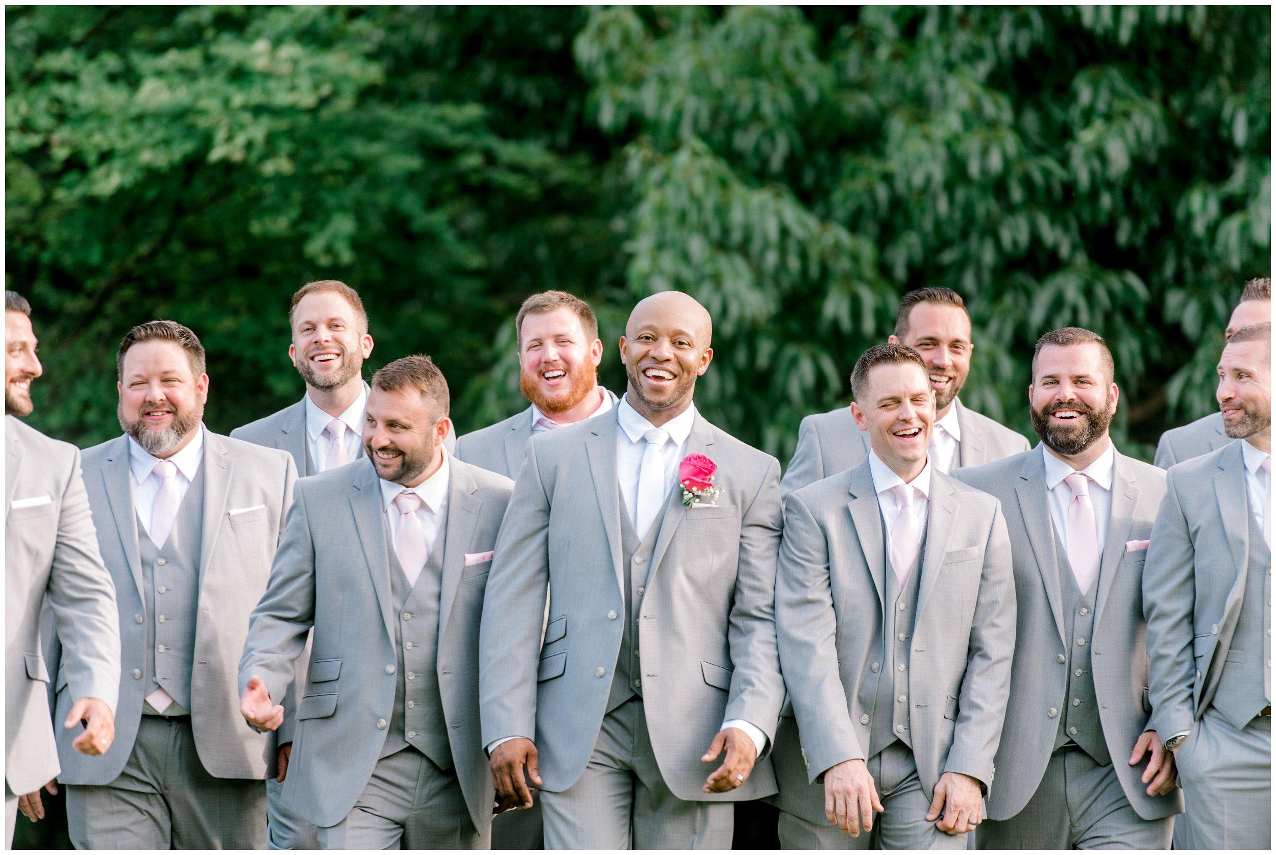 Groom with groomsmen walking