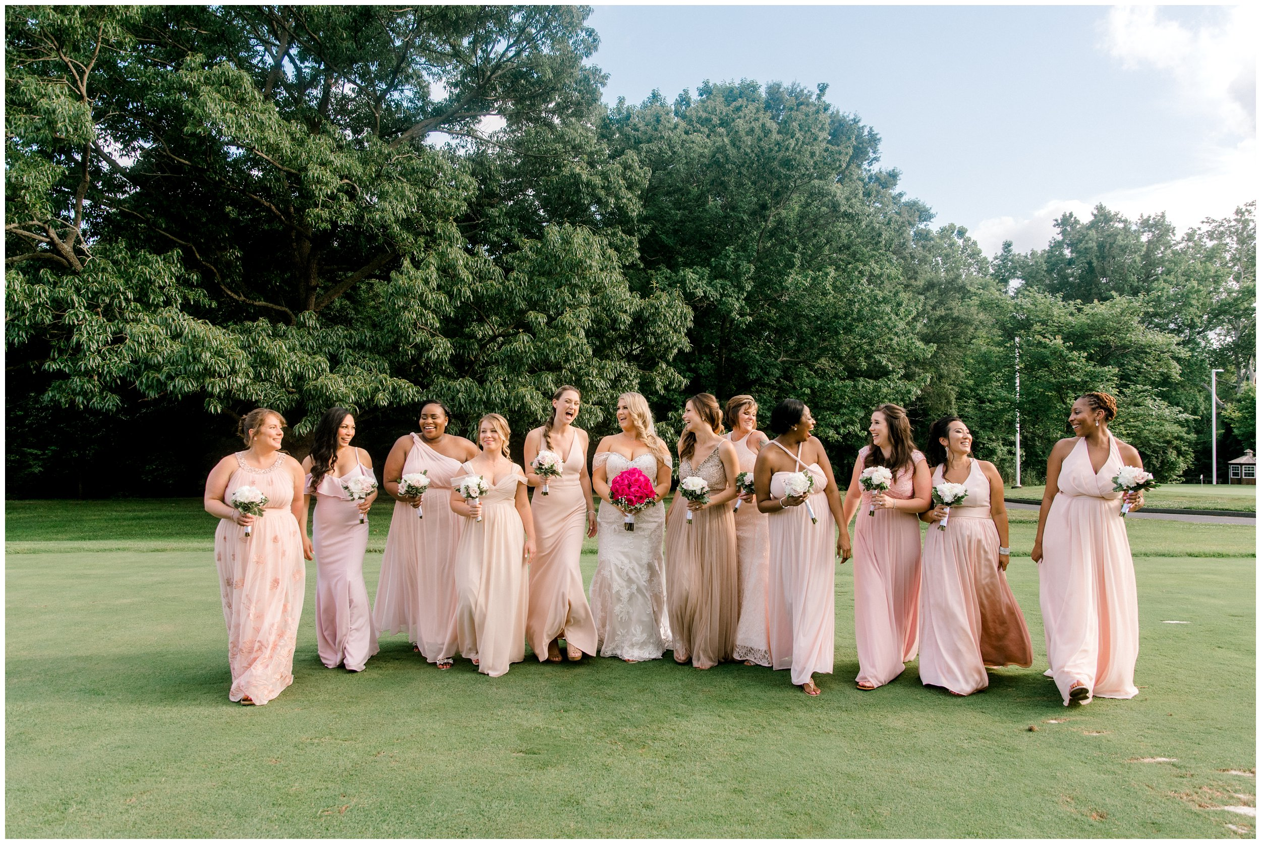 Bridal party laughing after Maryland wedding ceremony