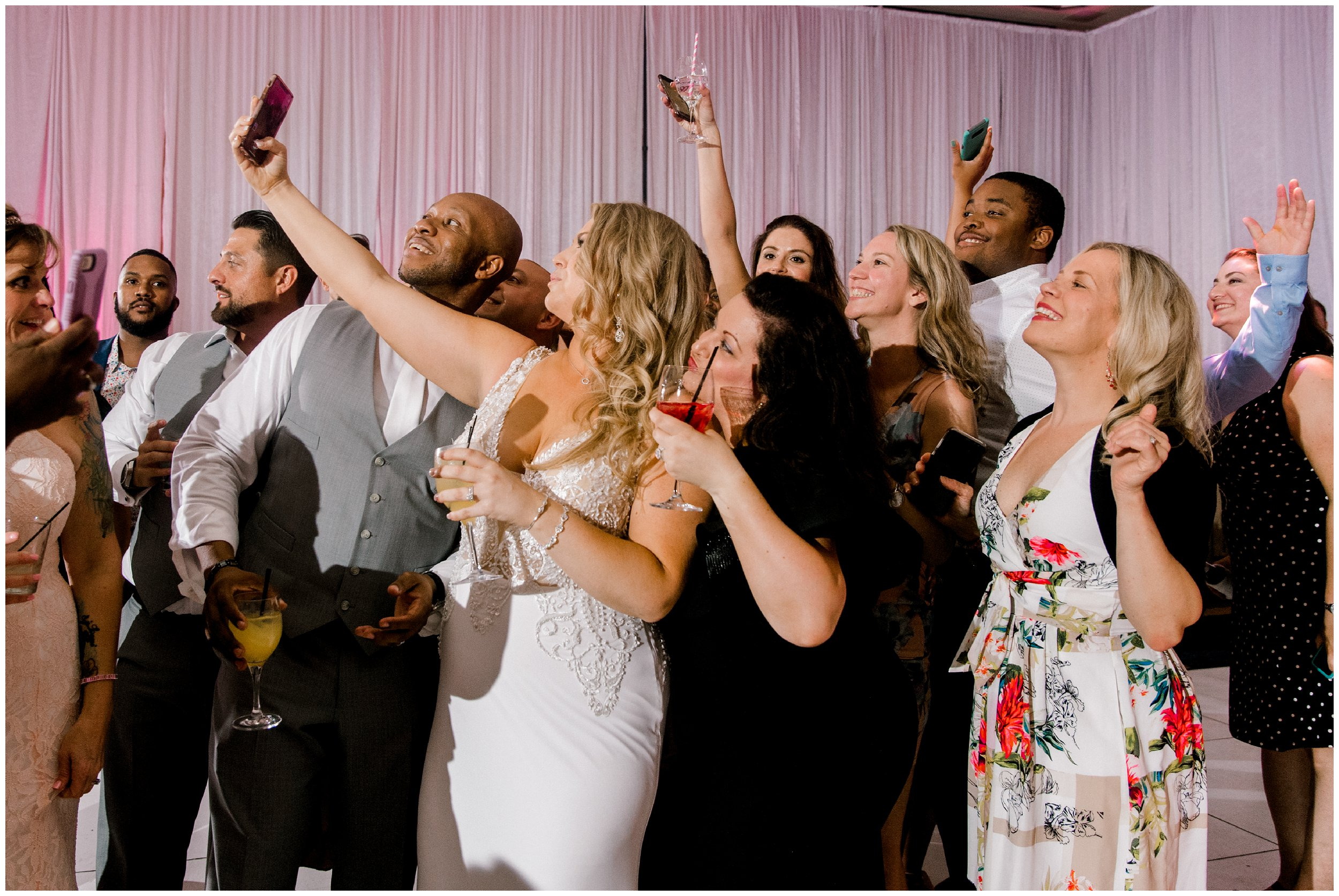 Guests take selfies with bride Maryland wedding