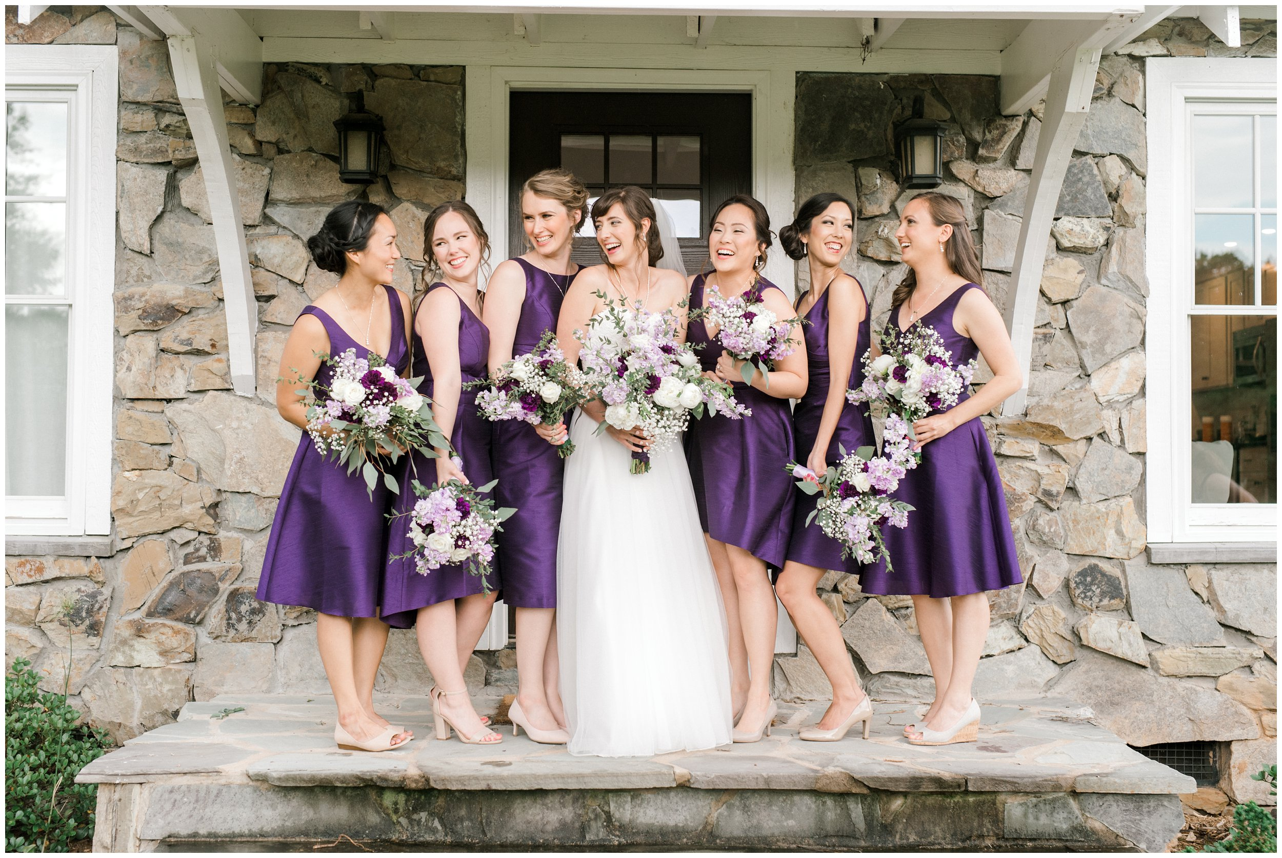 bridal party with lovely purple dresses and beautiful bouquets