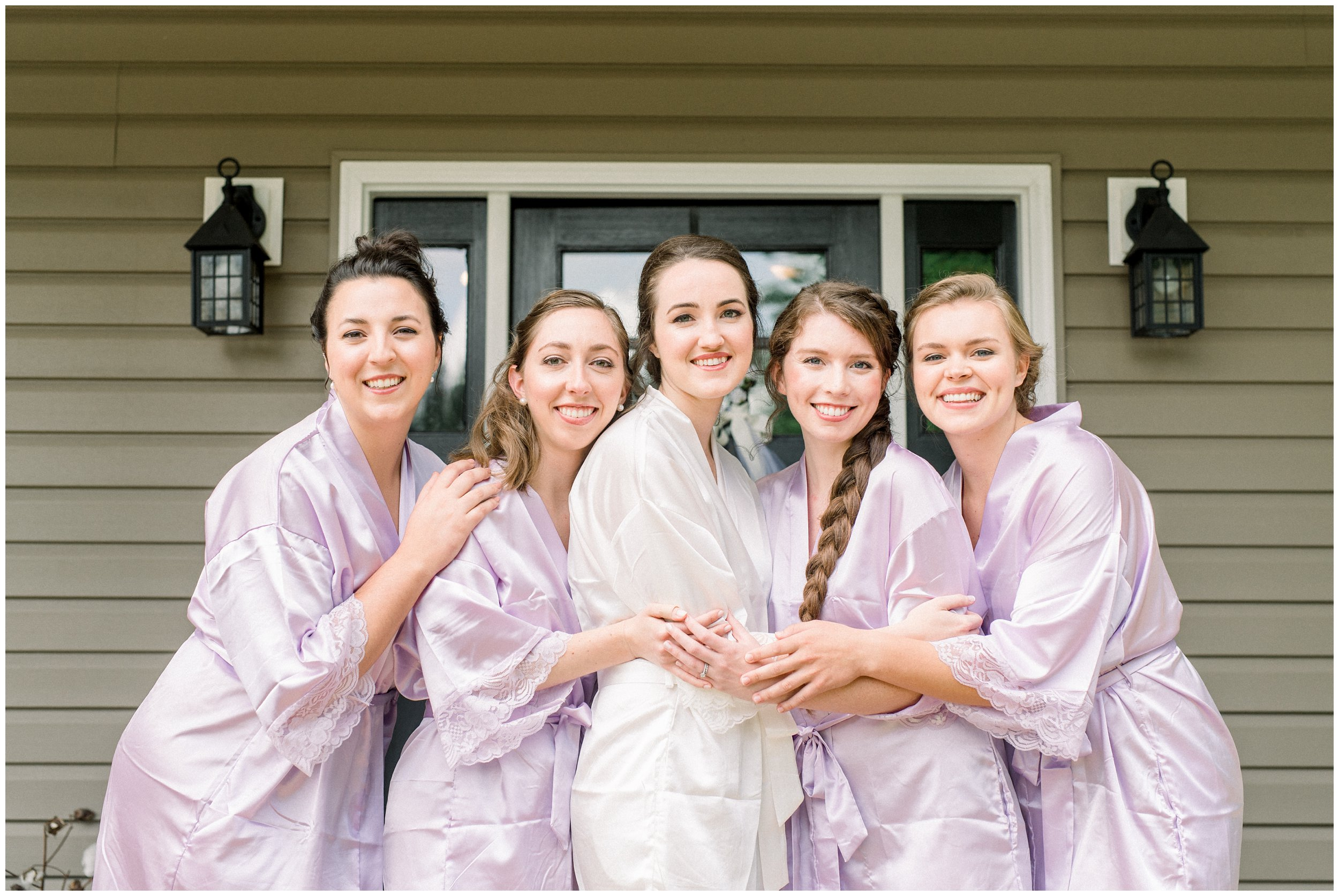 bridal party in lavender robes with bride