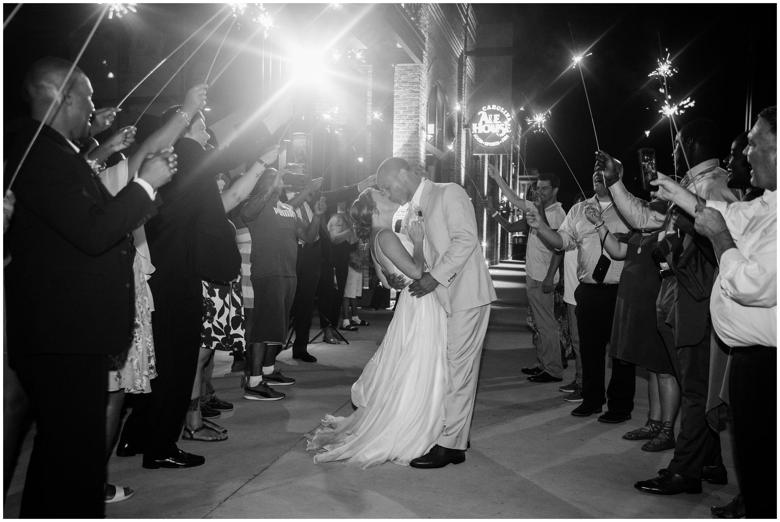 charlotte wedding sparkler exit bride and groom kissing