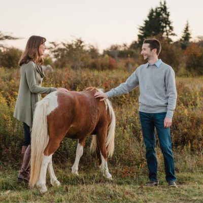 Engaged Couple Petting Ponies at Blue Ridge Mountains